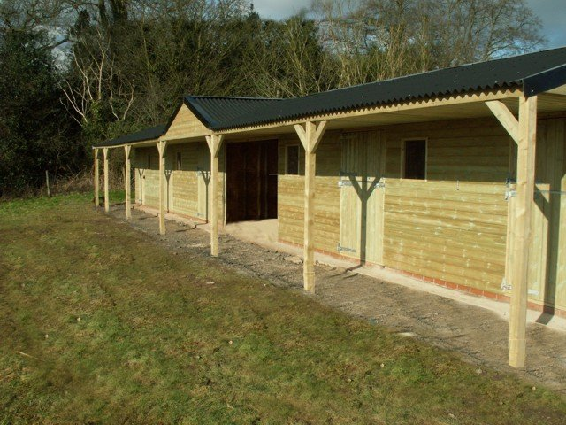 Fixed Timber Stable Block with Centre Hay Barn - angle