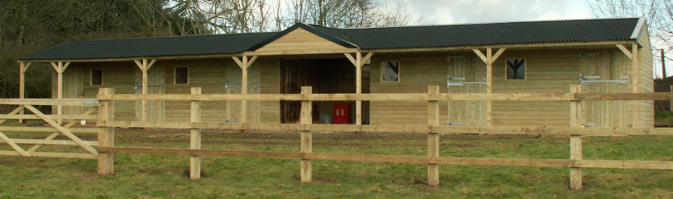 fixed timber stable block with centre hay barn