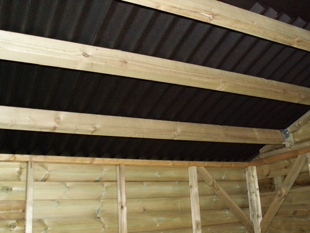 inside mobile stable looking at back corner and onduline roof