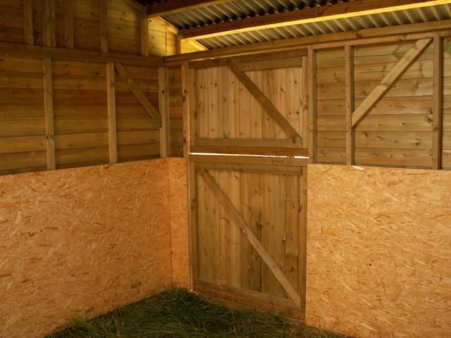 inside mobile stable looking at door